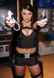 Allison Carroll as Lara Croft shows great cleavage attending a photocall for Sony Ericsson's W910 Gaming Edition -