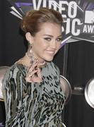 http://img161.imagevenue.com/loc495/th_393588852_Miley_Cyrus_1011_122_495lo.jpg